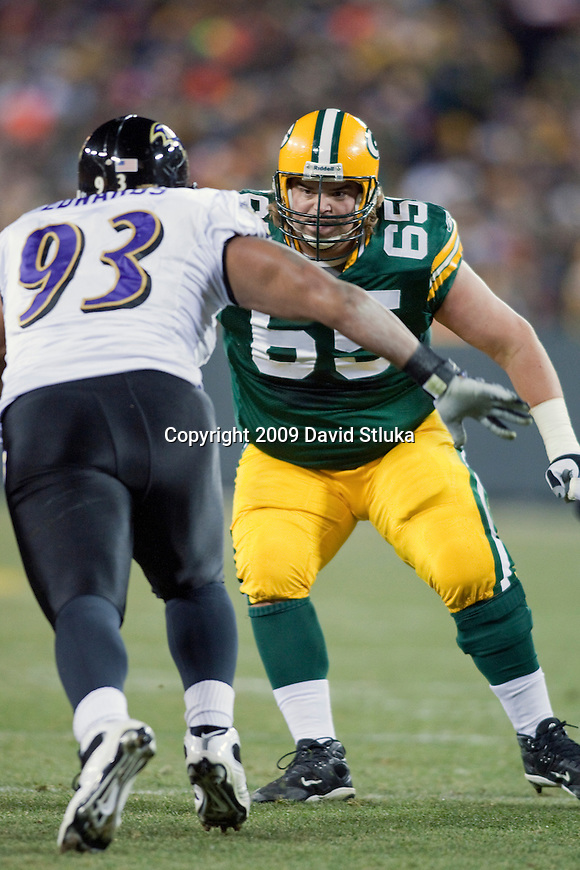 Green Bay Packers offensive lineman Mark Tauscher (65) prepares to block during an NFL Monday Night Football game against the Baltimore Ravens at Lambeau Field in Green Bay, Wisconsin on December 7, 2009. The Packers won 27-14. (AP Photo/David Stluka)