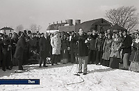 Dr. Jerry Falwell, Sr. prays with students, faculty, and  administrators on Jan. 21, 1977. The facility they had been using for classes was scheduled for demolition at the end of the semester. The group prayed in eight inches of snow for nearly two hours, asking God for financial stability and a place to call home. Miraculously, in only seven months, students entered two new classroom buildings as well as new residence halls on Liberty Mountain.