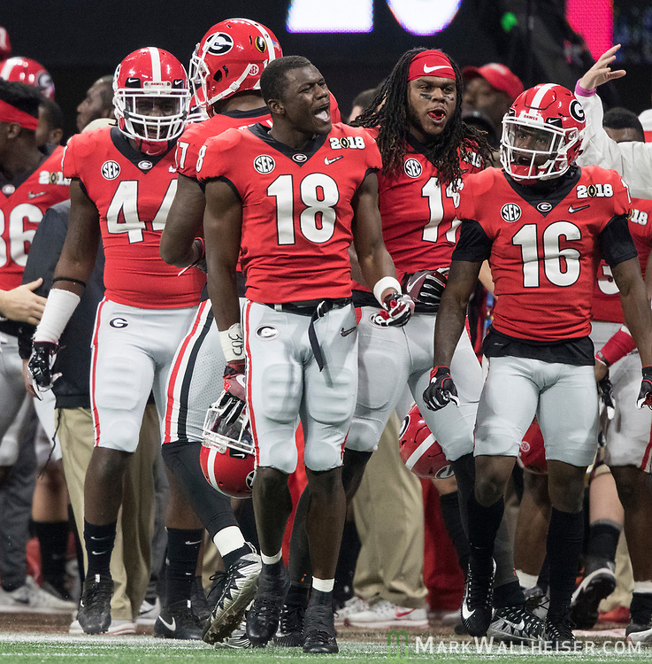 Georgia Bulldogs defensive back Deandre Baker (18) gegs flagged for excessive celebration after intercepting an Alabama pass in the third quarter of the NCAA College Football Playoff National Championship at Mercedes-Benz Stadium on January 8, 2018 in Atlanta. Photo by Mark Wallheiser/UPI
