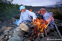 Young girls enjoying a campfire near the lake