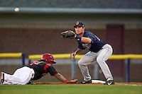 Lowell Spinners first baseman Tucker Tubbs (33) waits for a throw as Taylor Munden (21) dives back to first during a game against the Batavia Muckdogs on August 12, 2015 at Dwyer Stadium in Batavia, New York.  Batavia defeated Lowell 6-4.  (Mike Janes/Four Seam Images)