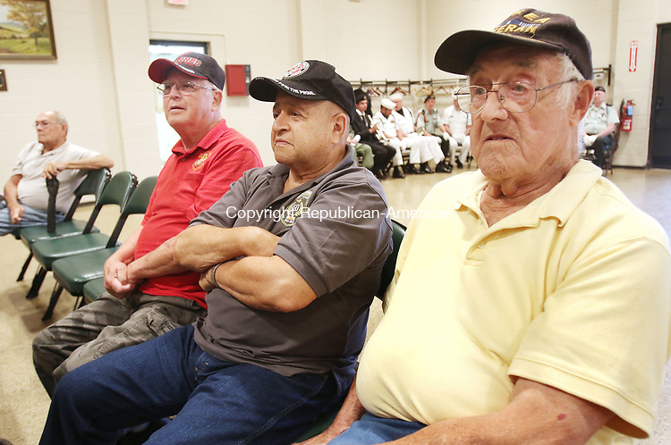 TORRINGTON CT. 27 July 2017-072717SV10-From left, Tom Clark of Torrington, Marine Corp. League, Sal Curcio of Torrington, Vietnam Veteran, and John Belcher of Torrington, Korean War Veteran listen to speaches during the Anniversary of the Korean War Armistice ceremony in Torrington Thursday.<br /> Steven Valenti Republican-American