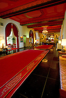 Gorgeous interior shot of the Royal Hawaiian Hotel lobby, showcasing the lush pink carpets.