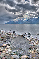 View of Tetons from rocky shore of Jackson Lake