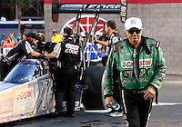 Oct 31, 2014; Las Vegas, NV, USA; NHRA funny car driver John Force walks along daughter top fuel driver Brittany Force during qualifying for the Toyota Nationals at The Strip at Las Vegas Motor Speedway. Mandatory Credit: Mark J. Rebilas-USA TODAY Sports