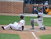 Baltimore, MD - April 6, 2009 -- New York Yankees catcher Jorge Posada (20) shows the ball to the umpire after tagging out Baltimore Oriole third baseman Melvin Mora (6) as he attempted to score to end the fifth inning at Oriole Park at Camden Yards in Baltimore, MD on Monday, April 6, 2009..Credit: Ron Sachs / CNP.(RESTRICTION: NO New York or New Jersey Newspapers or newspapers within a 75 mile radius of New York City)
