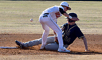 Westside Eagle Observer/MIKE ECKELS<br /> <br /> As a Wolverine player slides into second base, Lion Keegan Bulza (center) goes for the tag during the Gravette-Bentonville West baseball game at Lions Baseball field March 10. Unfortunately for Bulza, the ball popped out of his glove before making the tag which allowed the Wolverine runner to be call safe at second.