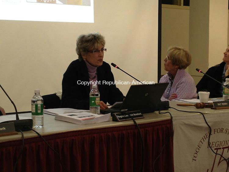 SOUTHBURY, CT - 24 Feb. 2014 - 022414BB02 -- Supt. Regina Botsford presents her budget proposal as school board members look back at the slide presentation. Bill Bittar Republican-American