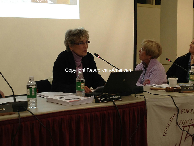 SOUTHBURY, CT - 24 Feb. 2014 - 022414BB02 -- Supt. Regina Botsford presents her budget proposal as school board members look back at the slide presentation. Bill Bittar Republican-American