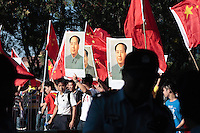 September 18 2012 - Beijing, China - Anti-Japan protesters are carrying portraits of Mao Zedong in a demonstration near the embassy of Japan to claim the Diaoyu Islands as a part of the chinese territory.