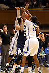 02 January 2014: ODU's Michelle Brandao (POR) (2) is tied by Duke's Ka'lia Johnson (14) and Alexis Jones (behind). The Duke University Blue Devils played the Old Dominion University Lady Monarchs in an NCAA Division I women's basketball game at Cameron Indoor Stadium in Durham, North Carolina. Duke won the game 87-63.