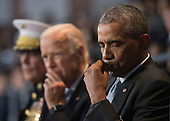 United States President Barack Obama (R), Vice President Joe Biden (C) and Chairman of the Joint Chiefs of Staff Gen. Joseph Dunford Jr. attends the Armed Forces Full Honor Review Farewell Ceremony for President Obama at Joint Base Myers-Henderson Hall, in Virginia on January 4, 2017. The five braces of the military honored the president and vice-president for their service as they conclude their final term in office.<br /> Credit: Kevin Dietsch / Pool via CNP