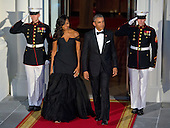 United States President Barack Obama and First Lady Michelle Obama walk out to welcome President XI Jinping of China and Madame Peng Liyuan to a State Dinner in their honor on the North Portico of the White House in Washington, DC on Friday, September 25, 2015.<br /> Credit: Ron Sachs / CNP