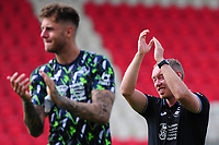 Steve Cooper Head Coach of Swansea City applauds the fans at the final whistle during the pre season friendly match between Exeter City and Swansea City at St James Park in Exeter, England, UK. Saturday, 20 July 2019