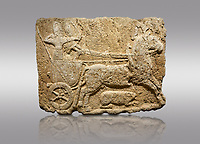 Picture &amp; image of Hittite monumental relief sculpted orthostat stone panel. Limestone, Karkamıs, (Kargamıs), Carchemish (Karkemish), 900-700 B.C. Hunting carriage. Anatolian Civilisations Museum, Ankara, Turkey.<br /> <br /> Two human figures; one handling the carriage, the other throwing arrows. Both figures are wearing a headdress shaped like a skullcap. The dagger at the waist of the figure throwing arrow draws attention. There is an animal between the legs of the horse having an aigrette over its head.  <br /> <br /> Against a gray background.