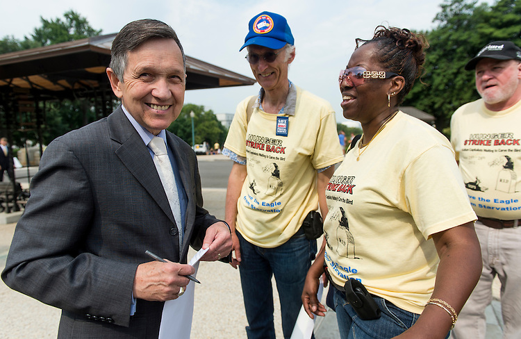 "UNITED STATES - JUNE 25: Rep. Dennis Kucinich, D-Ohio, speaks with members of the Postal Workers Union as he arrives for his news conference on their ""Hunger Strike to Save the Postal Service"" on Monday, June 25, 2012. The hunger strike is an effort to urge Congress to ""repeal the pre-funding mandate"" and ""refund the pension surplus."" (Photo By Bill Clark/CQ Roll Call)"