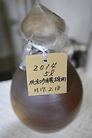 Sake matured in Bizen-yaki pottery. Shiragiku Shuzo, Takahashi city, Okayama Pref, Japan, January 27, 2014. Okayama is famous for its earthy full-bodied sake. In January and February 2014 a 5-day tour of breweries in the prefecture was organised by Sake Brewery Tours (www.saketours.com).