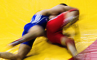 17 JUL 2010 - SHEFFIELD, GBR - Krasimir Krastanov (GBR) (blue) attempts to roll Alexandru Chirtdeca (MDA) (red) onto his shoulders  during their GB Cup match (PHOTO (C) NIGEL FARROW)