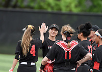 NWA Democrat-Gazette/CHARLIE KAIJO Northside High School players high-five during the 6A State Softball Tournament, Thursday, May 9, 2019 at Tiger Athletic Complex at Bentonville High School in Bentonville. Rogers Heritage High School lost to Northside High School 8-6