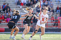 College Park, MD - April 27, 2019: Maryland Terrapins attack Kali Hartshorn (16) gets hit by John Hopkins Bluejays Ellie McNulty (55) during the game between John Hopkins and Maryland at  Capital One Field at Maryland Stadium in College Park, MD.  (Photo by Elliott Brown/Media Images International)