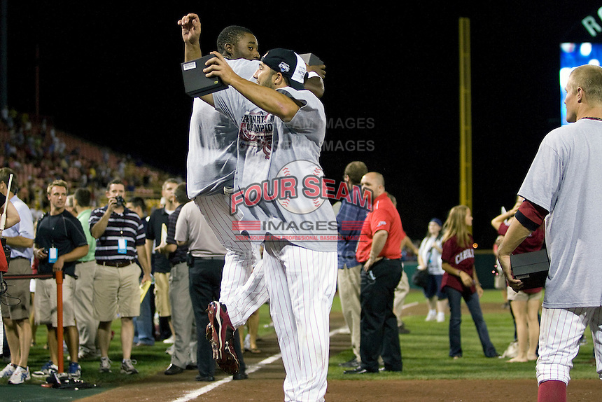 South Carolina CF Jackie Bradley Jr and Adrian Morales celebrate following their victory in Game Two of the NCAA Division One Men's College World Series Finals on June 29th, 2010 at Johnny Rosenblatt Stadium in Omaha, Nebraska.  (Photo by Andrew Woolley / Four Seam Images)
