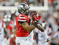 Ohio State Buckeyes wide receiver Devin Smith (9) makes a catch against Virginia Tech Hokies cornerback Chuck Clark (19) during the 2nd quarter of their game in Ohio Stadium on September 6, 2014.  (Dispatch photo by Kyle Robertson)