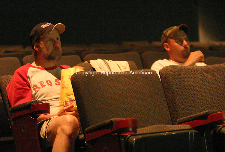 SOUTHINGTON, CT 05 July 2005 -070505BZ07-  Red Sox fans Ron LeVasseur, left, and his son Eric LeVasseur, both of Wolcott, watch the game on the large screen at Showcase Cinemas in Southington Wednesday night.<br /> Jamison C. Bazinet Photo
