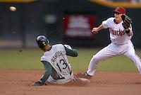 Jun 18, 2007; Phoenix, AZ, USA; Tampa Bay Devil Rays left fielder (13) Carl Crawford steals second base as Arizona Diamondbacks shortstop (6) Stephen Drew awaits the throw in the first inning at Chase Field. Mandatory Credit: Mark J. Rebilas