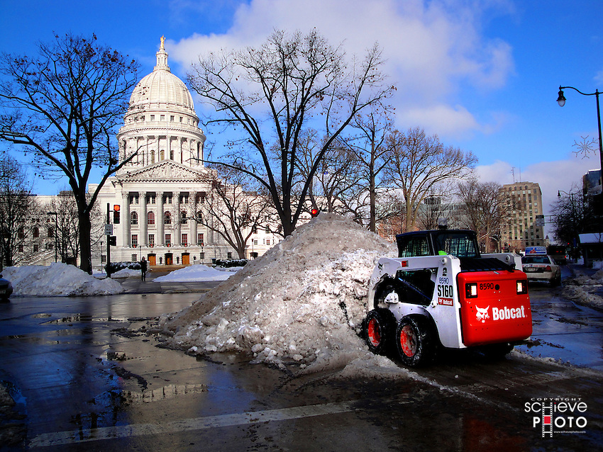 A bobcat clears snow from the Capitol Square in Madison, Wisconsin.