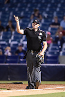Home plate umpire Derek Ivinski signals home run during a game between the Daytona Tortugas and Tampa Yankees on April 24, 2015 at George M. Steinbrenner Field in Tampa, Florida.  Tampa defeated Daytona 12-7.  (Mike Janes/Four Seam Images)