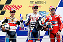 June 26, 2010 - Assen, Holland - (L-R) Dani Pedrosa, Jorge Lorenzo and Casey Stoner celebrate on the podium the victory at the end of the MotoGP race of the Dutch Grand Prix, Assen, Holland, on June 26, 2010. (Photo Andrew Northcott/Nippon News)