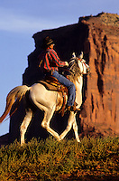 Indian horse rider in Monument Valley National Park and navaho Indian reservation,  Utah, USA