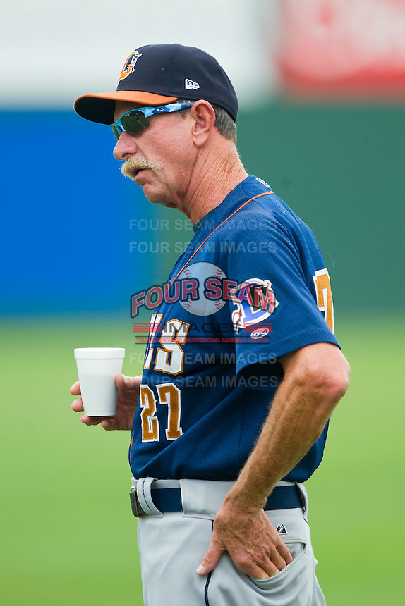Durham Bulls roving pitching coach Dick Bosman (27) watches his starting pitcher warm up in the outfield prior to the game against the Charlotte Knights at Knights Stadium on August 18, 2013 in Fort Mill, South Carolina.  The Bulls defeated the Knights 8-5 in Game One of a double-header.  (Brian Westerholt/Four Seam Images)