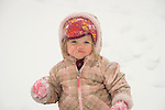 Toddler outdoors in snow.