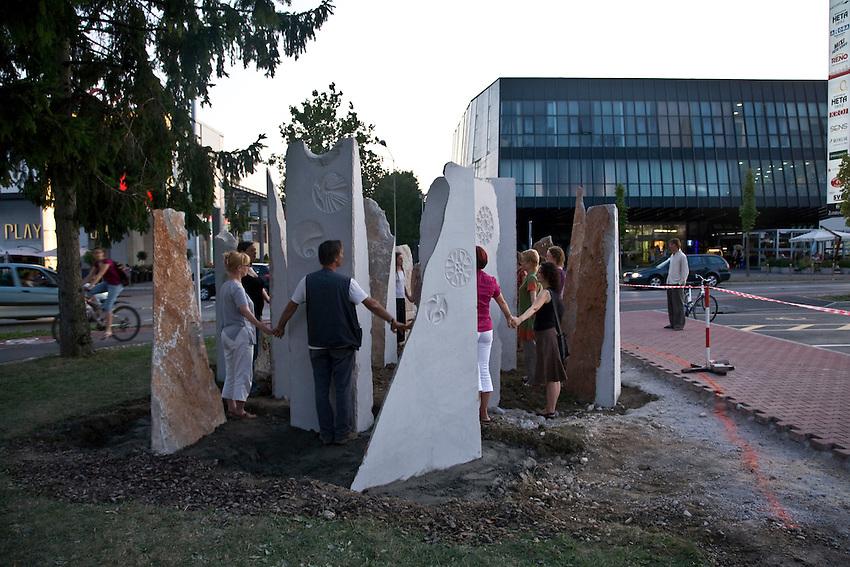"""Geopuncture Circle...""""PEACE POINT"""" in the middle of shopping center BTC City Ljubljana, Slovenia..Authors: Marko Poga?nik and VITAAA Association. Concept: Marko Poga?nik. Placement: Marko Poga?nik, Neboj?a Lon?ar, Jana Baraga...""""PEACE POINT"""" is a circle, composed of 14 natural stone pillars. Created by art group VITAAA - Association for Co-existence of Humanity, Nature, and Environment, under mentorship of sculptor Marko Poga?nik and through cooperation with BTC CIty..Purpose of """"PEACE POINT"""" is to strengthen peace and center of regeneration for man and Earth in the middle of shopping center..--------------------------------.Geopunkturni krog..""""TO?KA MIRU"""" SREDI TRGOVSKEGA CENTRA BTC CITY.Avtorji: Marko Poga?nik in dru?tvo VITAAA. Koncept: Marko Poga?nik. Postavitev: Marko Poga?nik, Neboj?a Lon?ar, Jana Baraga..TO?KA MIRU je krog, sestavljen iz 14 naravnih kamnitih stebrov. Postavile so ga sodelavke in sodelavci umetni?ke skupine Dru?tva za so?itje ?loveka, narave in prostora VITAAA pod mentorstvom kiparja Marka Poga?nika in v sodelovanju z upravo BTC..Namen TO?KE MIRU je vzdr?evati jedro miru in center regeneracije za ?loveka in za Zamljo sredi nakupovalnega vrve?a."""