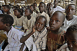Sitting on the ground, boys in class in a school in the Dereig Camp for internally displaced persons.