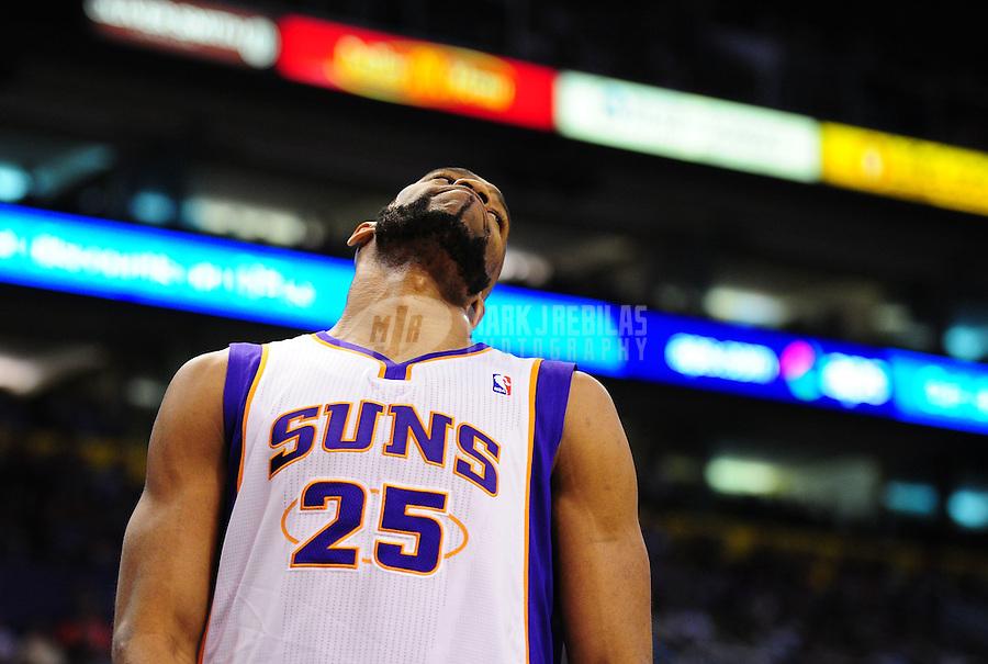 Mar. 30, 2011; Phoenix, AZ, USA; Phoenix Suns guard (25) Vince Carter reacts against the Oklahoma City Thunder at the US Airways Center. Mandatory Credit: Mark J. Rebilas-.