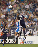 Puebla FC defender Juan Garcia (18) and New England Revolution defender Darrius Barnes (25) battle for head ball. The New England Revolution defeated Puebla FC in penalty kicks, in SuperLiga 2010 semifinal at Gillette Stadium on August 4, 2010.