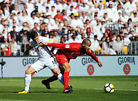 Peru's Alberto Rodriguez (right) holds off New Zealand's Marco Rojas during the 2018 FIFA World Cup Russia first-leg playoff football match between the NZ All Whites and Peru at Westpac Stadium in Wellington, New Zealand on Saturday, 11 November 2017. Photo: Dave Lintott / lintottphoto.co.nz