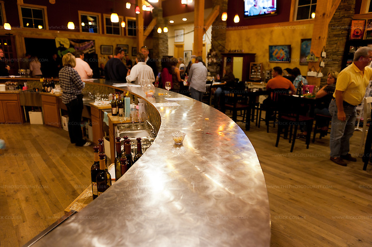 An attractive, brushed steel tasting bar occupies the center of the tasting room at Barrel Oak Winery.
