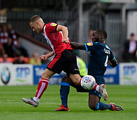 Lincoln City's Jack Payne vies for possession with Bristol Rovers' Abu Ogogo<br /> <br /> Photographer Chris Vaughan/CameraSport<br /> <br /> The EFL Sky Bet League One - Lincoln City v Bristol Rovers - Saturday 14th September 2019 - Sincil Bank - Lincoln<br /> <br /> World Copyright © 2019 CameraSport. All rights reserved. 43 Linden Ave. Countesthorpe. Leicester. England. LE8 5PG - Tel: +44 (0) 116 277 4147 - admin@camerasport.com - www.camerasport.com