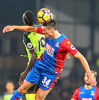 Martin Kelly of Crystal Palace wins an aerial challenge from Sadio Maneof Liverpool during the EPL - Premier League match between Crystal Palace and Liverpool at Selhurst Park, London, England on 29 October 2016. Photo by Steve McCarthy.