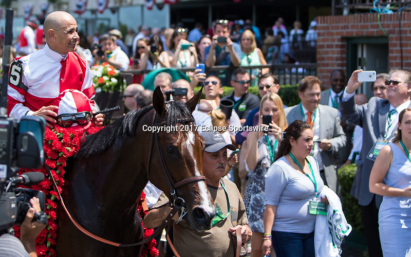 ELMONT, NY - JUNE 10: Mike Smith, aboard Songbird #5, smiles as he is led to the winner's circle after winning the Ogden Phipps Stakes on Belmont Stakes Day at Belmont Park on June 10, 2017 in Elmont, New York (Photo by Sue Kawczynski/Eclipse Sportswire/Getty Images)