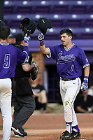 Second baseman Sims Griffith (1) of the Furman Paladins is congratulated after scoring a run in game two of a doubleheader against the Harvard Crimson on Friday, March 16, 2018, at Latham Baseball Stadium on the Furman University campus in Greenville, South Carolina. Furman won, 7-6. (Tom Priddy/Four Seam Images)