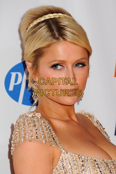 PARIS HILTON.18th Annual Race To Erase MS held at the Hyatt Regency Century Plaza Hotel, Century City, California, USA..April 29th, 2011.headshot portrait hair up bun braid plait gold beads beaded embellished jewel encrusted cleavage .CAP/ADM/BP.©Byron Purvis/AdMedia/Capital Pictures.