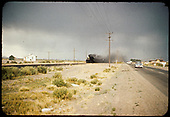 Train along highway south of Alamosa.<br /> D&amp;RGW  Alamosa, CO