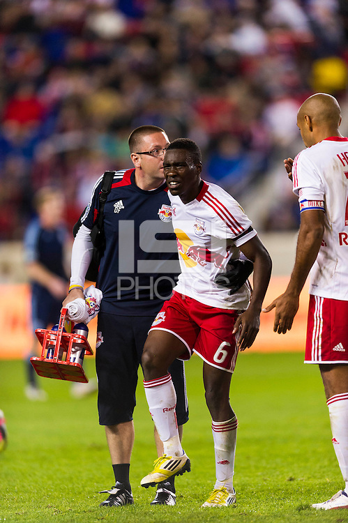 Lloyd Sam (10) of the New York Red Bulls is helped off the field with an injury. The New York Red Bulls and Sporting Kansas City played to a 0-0 tie during a Major League Soccer (MLS) match at Red Bull Arena in Harrison, NJ, on October 20, 2012.