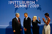 Pittsburgh, PA - September 24, 2009 -- United States President Barack Obama (2L) and U.S. first lady Michelle Obama (R) welcome Canadian Prime Minister Stephen Harper (L) and his wife Laureen Harper to the opening dinner for G-20 leaders at the Phipps Conservatory on Thursday, September 24, 2009 in Pittsburgh, Pennsylvania. Heads of state from the world's leading economic powers arrived today for the two-day G-20 summit held at the David L. Lawrence Convention Center aimed at promoting economic growth.  (Photo by Win McNamee/Getty Images).Credit: Win McNamee / Pool via CNP