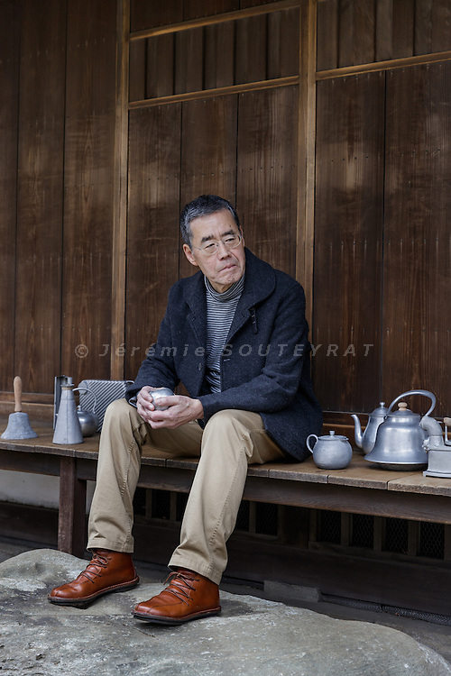 Tokyo, Japan, March 18 2016 - Portrait of Japanese collector and industrial designer Seiji OHNISHI. Mr OHNISHI collected aluminium objects of daily use : tools, cooking ustensils, household appliances, items of furniture and toys. All were produced as objects of anonymous design in the period from 1910 to around 1960, when Japan's modernisation began to take hold following World War II. As a populous island nation with few mineral resources, the country has a long tradition of reclaiming and reusing materials. Today, Japan is the world leader in the re- cycling of aluminium cans and especially during the war and in the post-war period, objects that would normally be made of steel, wood or ceramic were produced there in aluminium – a material which is expensive to manufacture in the first place but very easy to process.