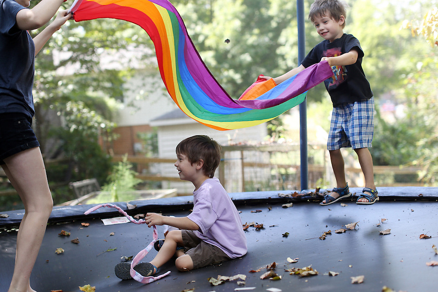 Cohen, Cooper and Beckha on the trampoline at home in Albemarle County, Va. Photo/Andrew Shurtleff